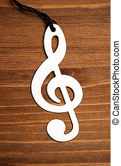 treble clef on brown wooden background