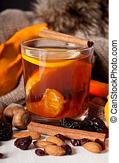 Glass with hot tea - Glass with a hot tea and winter flavour