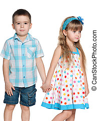 Two fashion children on the white background