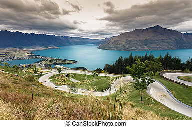 Luge track with beautiful lake and mountain at Skyline,...
