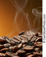 coffee beans with smoke - pile of roasted coffee beans with...