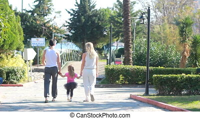 Family having  walk outdoors in summer