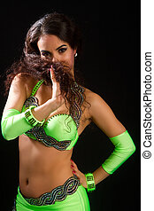 brunette in a green suit oriental dance