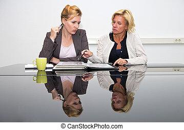 Design delibrations - Two senior artdirectors, deliberating...
