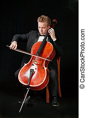 cello player - young caucasian cello player with black...