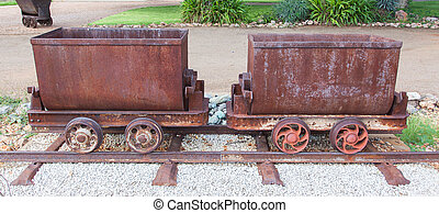 Rusted old mining carriages filled with stones, Namibia