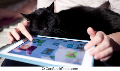 Browsing on touchpad - Woman browsing on touchpad with black...