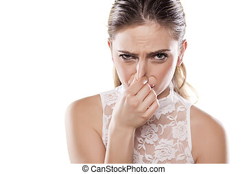 smelly environment - girl pinches her nose with her...