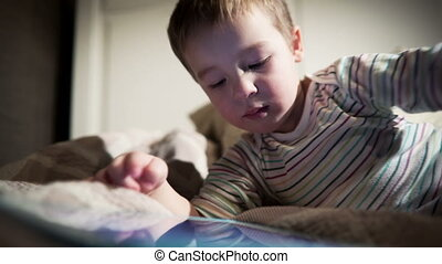 Boy using touchpad - Little boy using touchpad and scrolling...