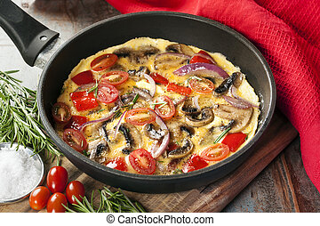 Vegetable Omelet in Skillet - Vegetable omelet cooked in a...