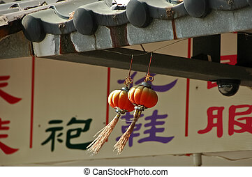 red Chinese lanterns in windy day