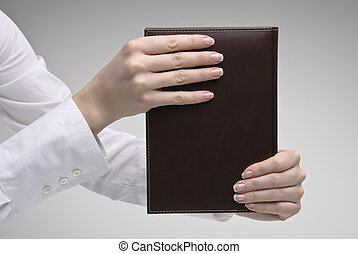 Woman\'s hands holding diary - Woman\'s hands holding brown...
