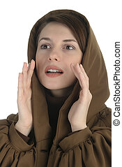 Young woman in a hood colling