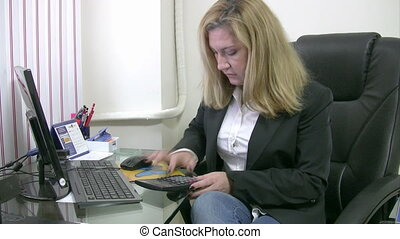 Businesswoman calculating data