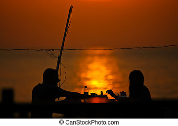 romantic couple dating at sun set