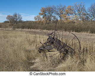 Old Farmstead - An old farm implement left to die a slow...