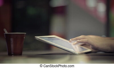 Woman typing on touchpad