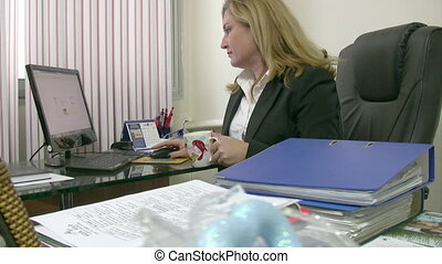Businesswoman working and smiling