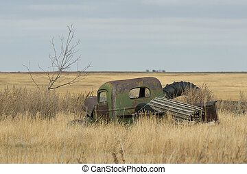 Old Farm Truck - An old rusty farm truck left in the grass...