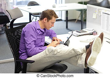 bad sitting posture - Young businessman caucasian in his...