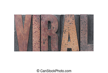 viral in old ink-stained wood type - the word viral in old...