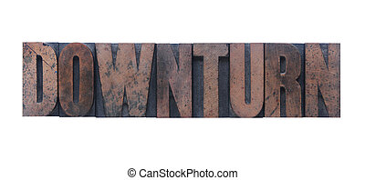 downturn - the word downturn in old ink-stained wood type...