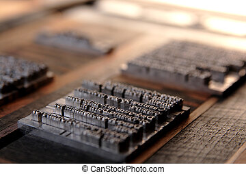 metal type blocks - letterpress metal type secured in a...