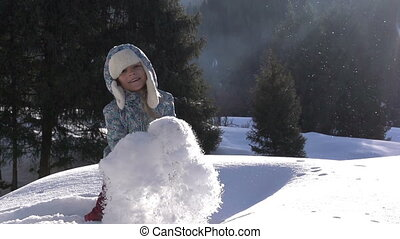 Girl and Snow - Girl throws fluffy snow on a background of a...