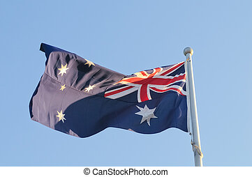 Waving Australia National Flag in windy day
