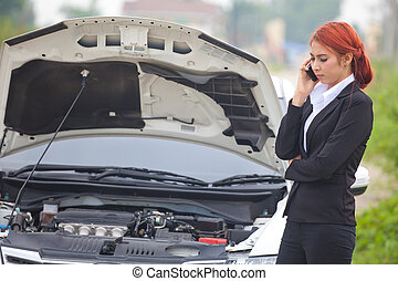 Woman with car broke down - Young beautiful business asian...
