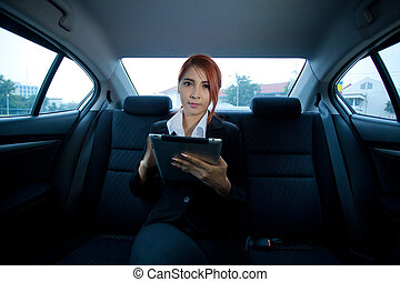 woman using tablet - Young business asian woman inside her...