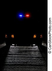 Night patrol - A police car at night with its lights on.