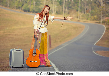 Hippie girl hitchhiking - Hippie girl with guitar...