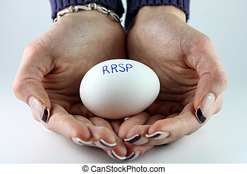 RRSP Nest Egg - A womans hands holding an egg with...