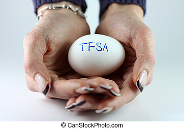TFSA Nest Egg - A womans hands holding an egg with TFSATax...