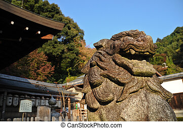 Japanese stone lion statue in old temple, Kyoto, Japan