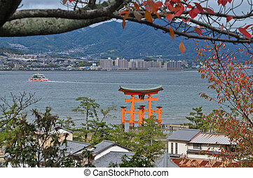 Historical red sacred Miyajima gate in Hiroshima Japan
