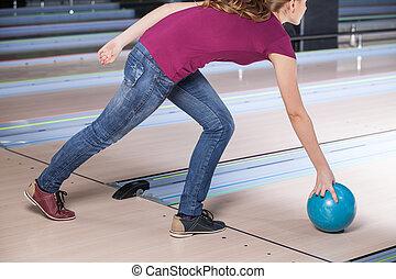 Woman Bowling. A woman having fun while bowling.