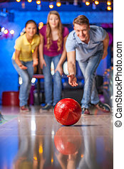 Group of friends bowling. Happy group of friends having fun...