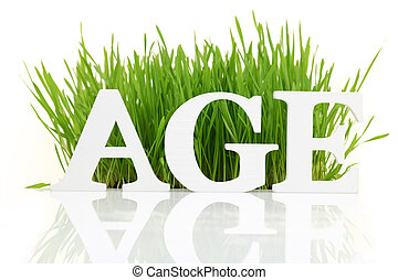 Word quot;Agequot; with fresh grass isolated on white - Word...