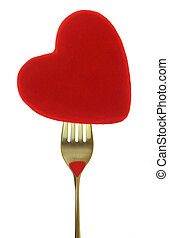Red heart on fork isolated on white background