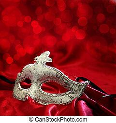 Vintage venetian carnival mask on red background