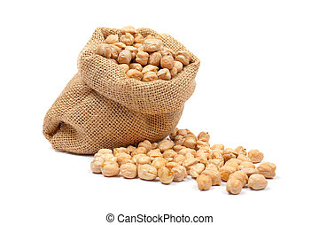 Burlap sack with chickpeas spilling out over a white...