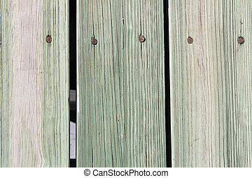 Green and Brown Wood Plank Walkway - Closeup of nailed green...