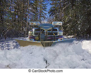 Snow plow truck clearing the driveway of snow