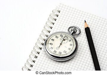 chronometer and pen - chronometer and black pen over...