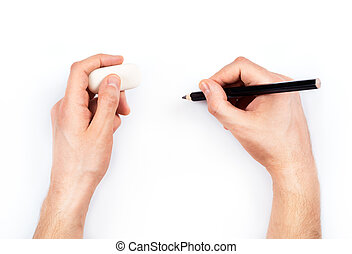 Human hands with pencil and erase rubber writting something....
