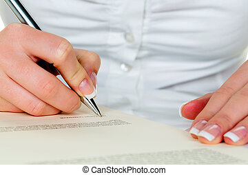 hand with fountain pen signing contract. sign woman while