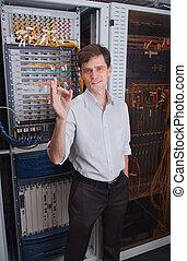 Network engineer in server room