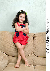 little girl and folded arms